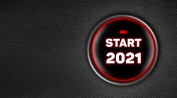 Modern ignition car button with a round red light. Inside of the circle the text: START 2021. Background black textured leather with copy space