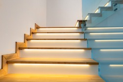 Modern illuminated wooden staircase indoor.