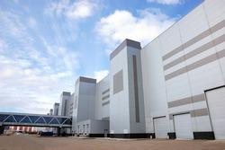 Modern industrial building over blue sky