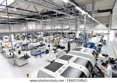 Photo of  modern industrial factory for the production of electronic components - machinery, interior and equipment of the production hall