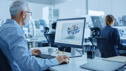 Modern Industrial Factory: Team of Mechanical Engineers Working on Computers, Using Newest High-Tech Devices Like Virtual Reality Headsets to Design Best Engines. 3D Graphics in Contemporary Industry