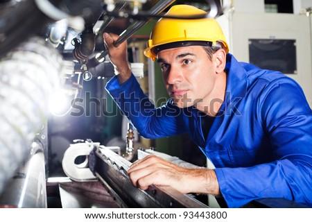 Shutterstock modern industrial machine operator working in factory