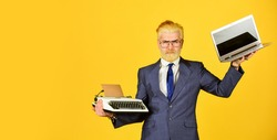 Modern instead outdated. Connoisseur of vintage values. Typewriter against laptop. Businessman use modern technology. Man dyed beard hair yellow background. Buy new modern gadget. Useful device.