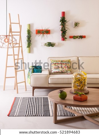 modern interior blue rug and wooden chair with wooden wall decoration, modern lamp