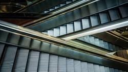 Modern interior design, modern escalators, chrome escalators. Black and White , monochrome, abstract artistic view. Modern art. Steel design. Architecture.