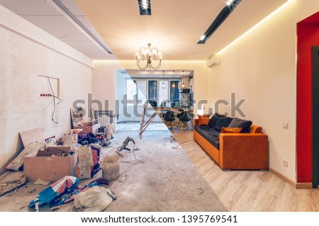 Modern interior design of big living-kitchen studio room, before and after Photo stock ©