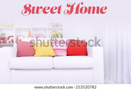 Modern interior design. White living room with sofa and bookcase. Sweet Home concept