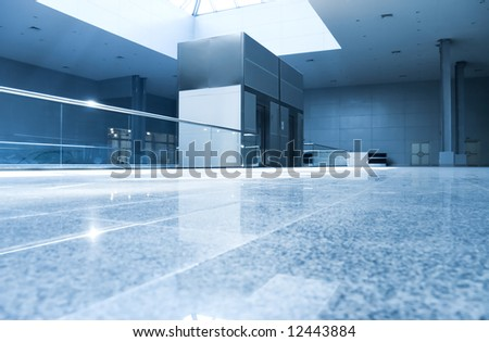 Modern interior in business center. Blue tint.