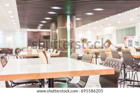Modern interior of cafeteria or canteen with chairs and tables, nobody #695586205