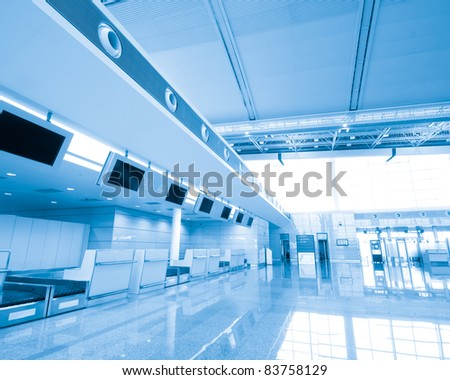 Modern interior of famous  International Airport. Security control machines and departures area.