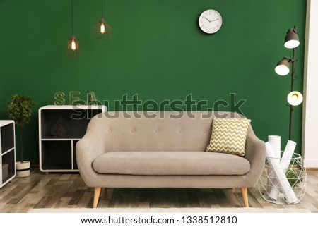 Modern interior of living room with stylish sofa. Contemporary design #1338512810