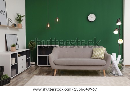 Modern interior of living room with stylish sofa. Contemporary design #1356649967