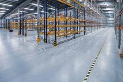 Modern interior of new empty warehouse. Racks pallets shelves. Metal construction. Storage equipment. Distribution storehouse.