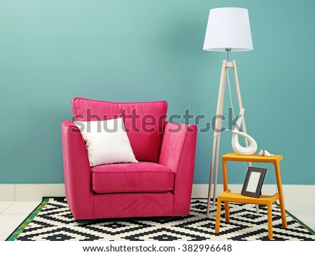 Modern interior of room with armchair on blue wall background