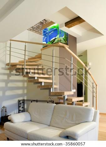 Modern interior. Staircase with aquarium