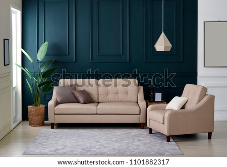 Modern interior style with beige couches and plants