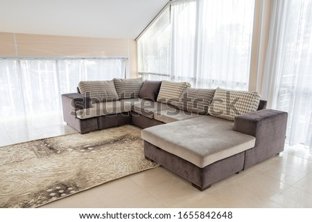 Modern interior with big sofa and a large windows - Image