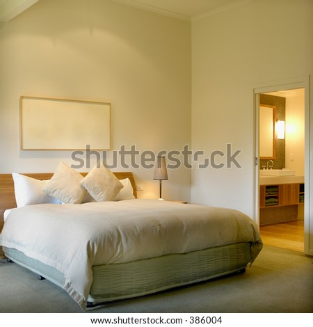Modern Interior With King Size Bed And Bathroom In