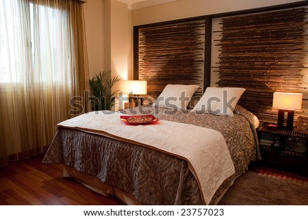 Modern interior with King size bed with wall decoration