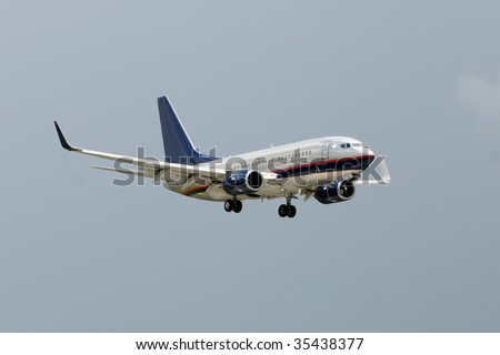 Modern jet airplane approaching airport for landing