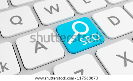 Modern keyboard with a blue SEO key, with selective focus. Concept for Search Engine Optimization.