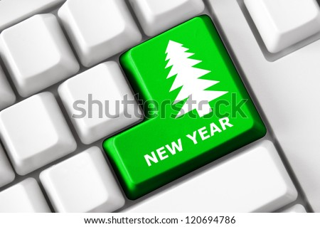 Modern keyboard with color button, fir image and new year text. Concept