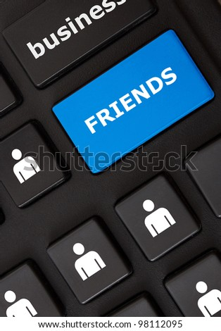 Modern keyboard with friends text and people symbols. Social network concept