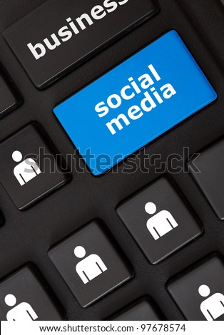 Modern keyboard with social media text and people symbols. Social network concept
