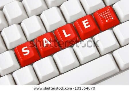 Modern keyboard with text sale on buttons and shopping cart symbol.Concept - stock photo