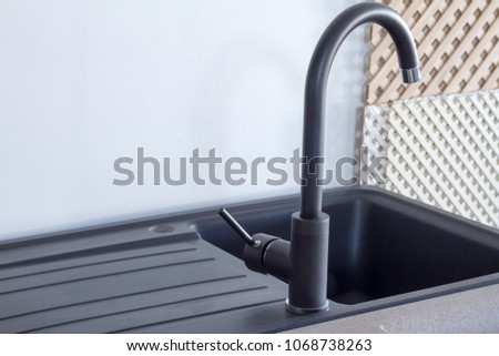 Modern kitchen and bathroom water faucets in the store #1068738263