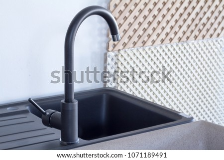 Modern kitchen and bathroom water faucets in the store #1071189491