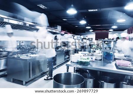 modern kitchen and chefs in hotel