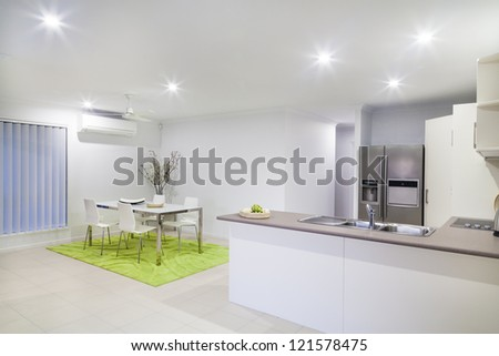 Modern kitchen and dining area in modern suburban house