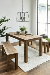 Modern kitchen and dining area. Wooden dining table