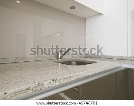 modern kitchen counter closeup with granite worktop