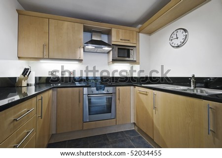 modern kitchen counter with hard wood finish and granite worktop stock photo 52034455 shutterstock