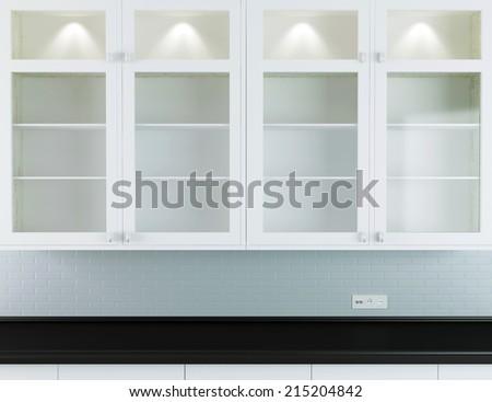 Modern kitchen design, white furniture with black worktop. #215204842