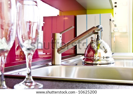 modern kitchen faucet and teapot