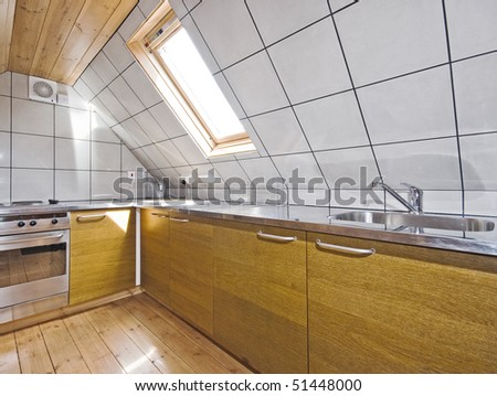 modern kitchen in a loft room with roof window