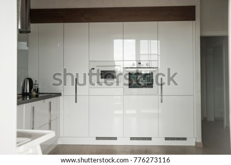 Modern kitchen in a residential house interior od white modern