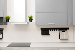 modern kitchen  in scandinavian style with hob, fume hood and countertop.