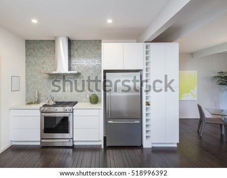 Modern kitchen interior. Design concept with new stainless steel appliances.
