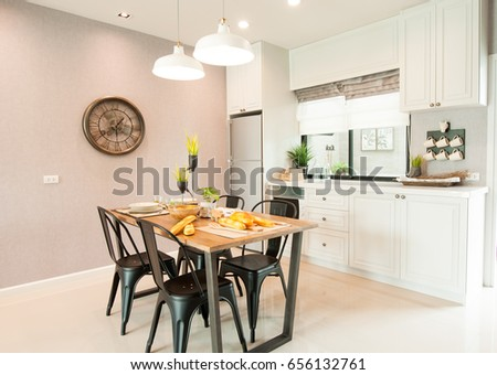 Modern Kitchen Interior Design with Fridge and dinning table Stock photo ©