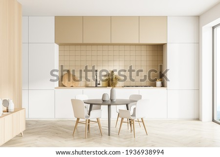 Modern kitchen interior, dining area with panoramic windows. Furnished by table and chairs for eating, wooden sideboard. Parquet floor. 3d rendering.