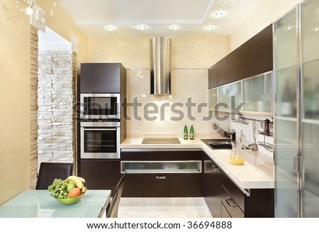 Modern Kitchen interior in warm tones - stock photo