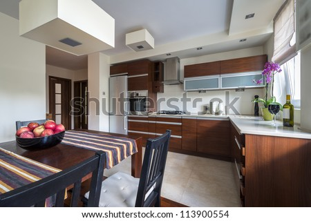 Modern kitchen interior with dinning room