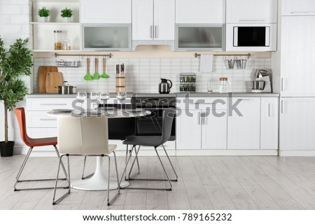 Modern kitchen interior with electric and microwave oven #789165232
