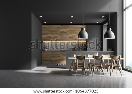 Modern kitchen interior with gray and white brick walls, a concrete floor and gray and wooden countertops. A long table with chairs near it. A mock up wall. 3d rendering