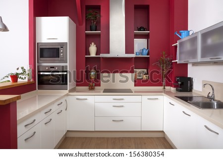 Modern Kitchen Interior With Red Walls And White Furniture