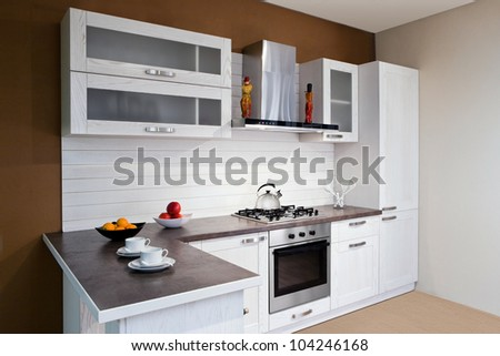 Modern kitchen interior with white decoration - stock photo